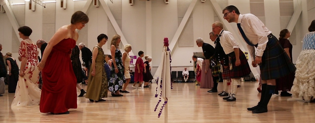 Dancers at a ball, bows and curtsies. Photo credit: Fiona Miller.
